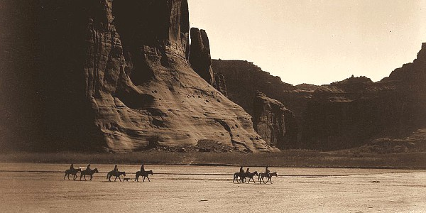 Riders on the Canyon de Chelly canyon floor