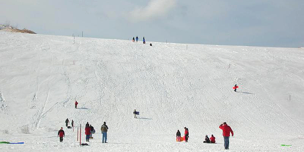 Sledding at Sleeping Bear Dunes